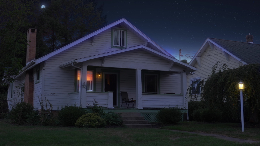 A night or dusk wide establishing shot of a typical middle class New England home. Various lights turn on and off. Moon in the distance. Pittsburgh suburbs. Day winter versional available.