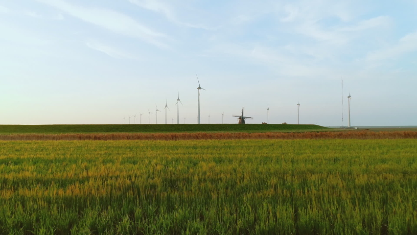 Historical windmill Goliath near wind rbines in Eemshaven harbor area / Delfzijl, Groningen, Netherlands,Nare Royalty-Free Stock Footage #1058481319