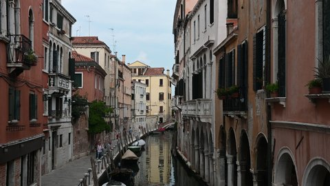 Venice, Italy - August 2020 - Walking among the palaces and monuments of the lagoon city, meeting unknown tourists strolling