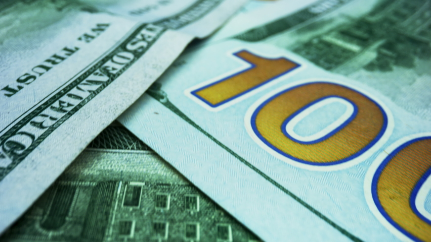 Pile of american dollars cash money, inflation concept. Closeup new american one hundred dollar bills. Back view US money banknotes of new 100 dollars. New hundred dollar bills background Royalty-Free Stock Footage #1058505598