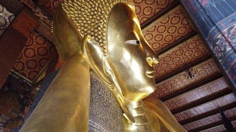 Reclining Buddha at Wat Pho in Bangkok, Thailand.