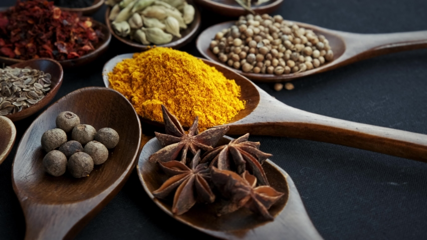 Various Indian Spices of rotation black background. Royalty-Free Stock Footage #1058549635