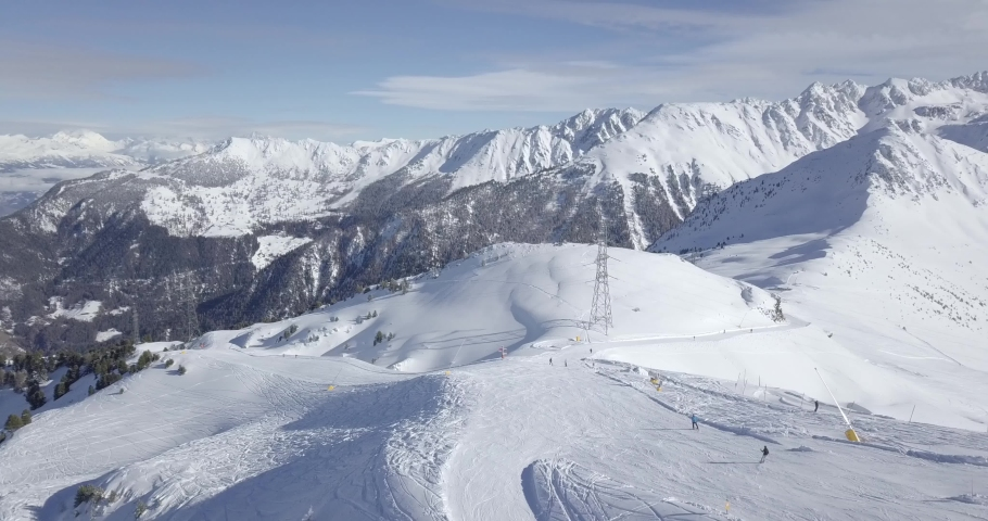 Aerial view of Snow covered Mountains Winter landscape | Shutterstock HD Video #1058562376