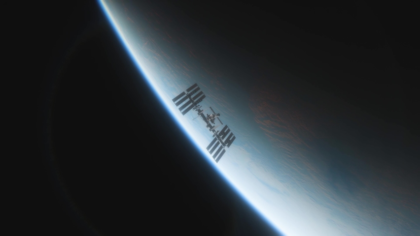 International Space Station ISS Floating in Orbit above Planet Earth in outer space | Shutterstock HD Video #1058576290