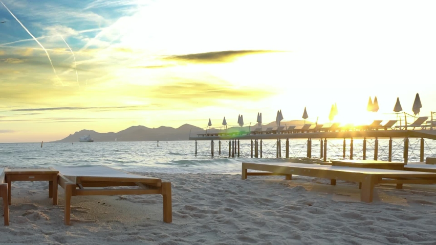 Luxury beach of Cannes. Shot of an orange sunset - French Riviera