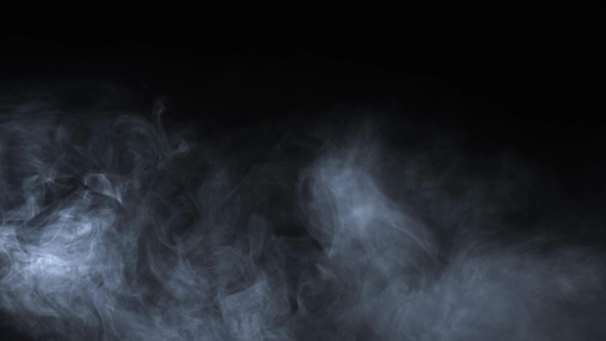 Abstract white smoke in slow motion. Smoke, Cloud of cold fog in light spot background. Light, white, fog, cloud, black background, 4k, ice smoke cloud. Floating fog. Royalty-Free Stock Footage #1058614003