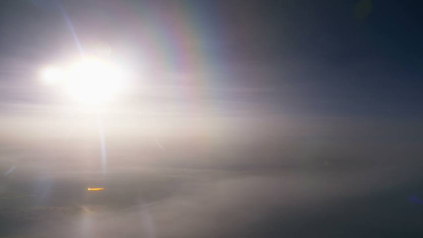 Sun above the clouds during flight in 4k | Shutterstock HD Video #1058617858