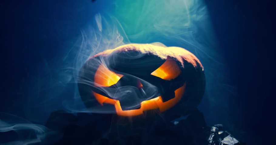 Pumpkin to celebrate Halloween on a wooden background  | Shutterstock HD Video #1058622331