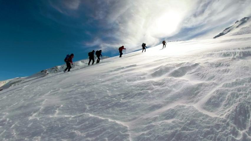 Successful winter walking team and harmonious, rhythm team success Royalty-Free Stock Footage #1058642788