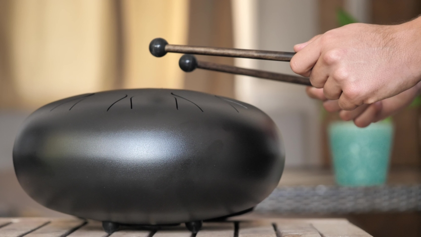 Improvising tunes on steel tongue drum rare music playing instrument, made from propane tank and also known as tank drum or hank drum similar to Pantam.   | Shutterstock HD Video #1058646415