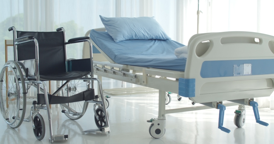 Dolly Medium shot, The comfortable recovery room for the patient in convalescent hospital, Bed and wheelchair preparing for patient, Healthcare and medical concept