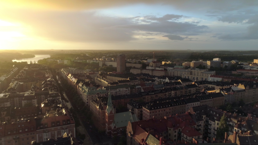 Stockholm city rainy sunset aerial view. Drone shot flying over apartment buildings in central Stockholm at dusk Royalty-Free Stock Footage #1058653618