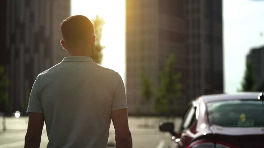 The man is going to his car. slow motion   Shutterstock HD Video #1058654038