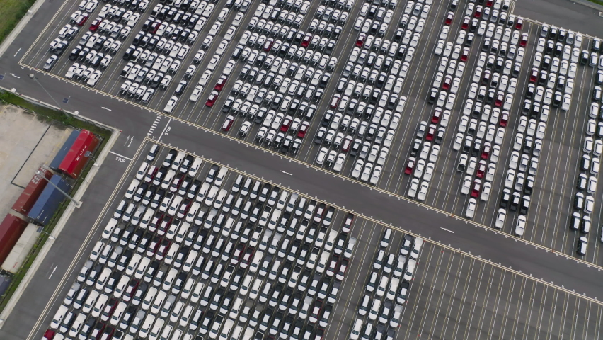 Aerial top view of new cars parking for sale stock lot row, dealer inventory import and export business commercial worldwide, Automobile and automotive industry distribution logistic global transport