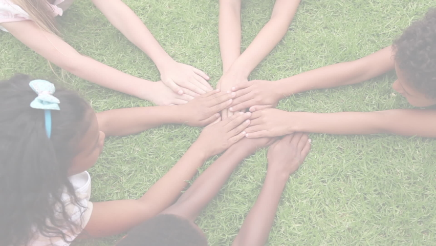 Digital composite video of Jigsaw puzzle forming a square against kids stacking their hands together in the garden. Autism Awareness concept  | Shutterstock HD Video #1058669377