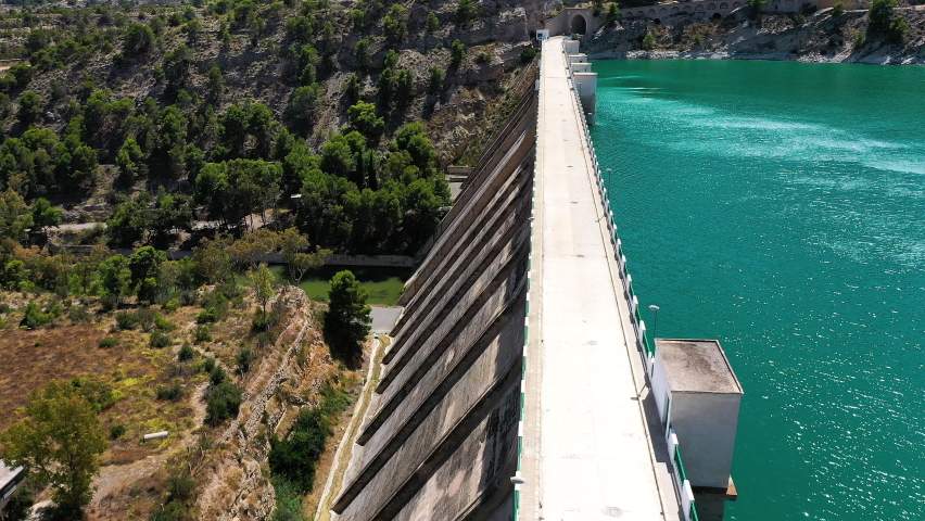 Aerial view of the wall of Amadorio river dam, in the village of Villajoyosa, Spain. | Shutterstock HD Video #1058680942