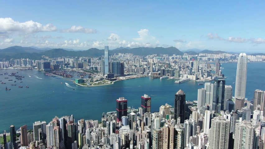 Hong Kong skyline with skyscrapers and bay view on a beautiful clear day, Aerial view.