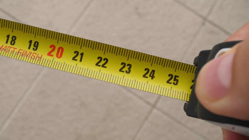 Measuring tape roller rolling, hiding pocket tape measures | Shutterstock HD Video #1058698324