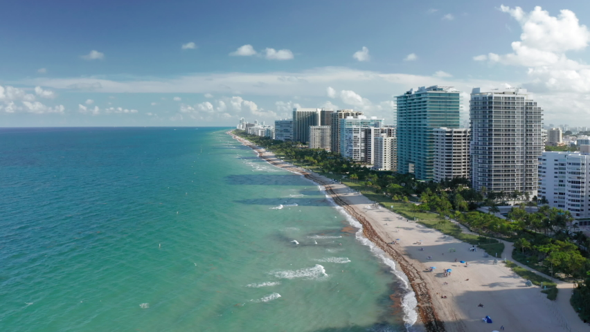 Best background for travel business. Aerial view of clean light-green sea waters. Residential front line buildings with beautiful Atlantic ocean view. South Beach nature at sunset, Florida, Time Lapse