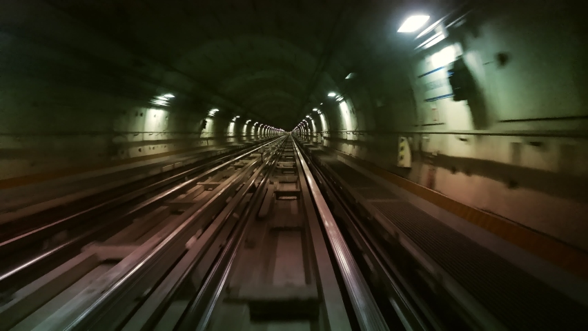Hyperlapse POV Train riding in the subway tunnel. Time lapse of automatic train moving to tunnel Royalty-Free Stock Footage #1058704756