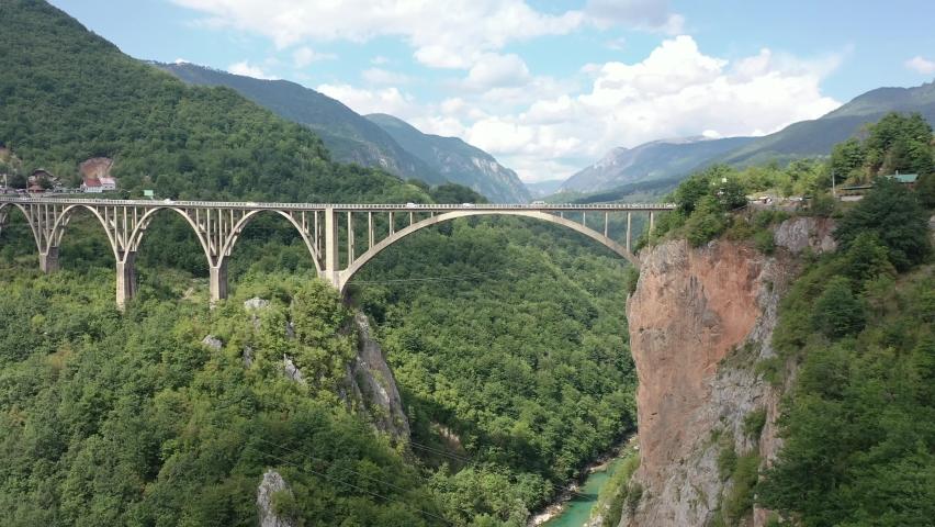 The Djurdjevic Bridge in Montenegro is a concrete arch bridge across the Tara River. Aerial. Drone footage.