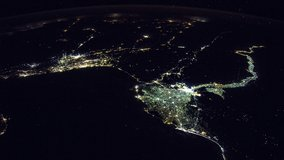 ISS Time-lapse Video of Earth seen from the International Space Station with dark sky and city lights at night over Nile , Time Lapse 4K. Images courtesy of NASA. Pan down motion timelapse.