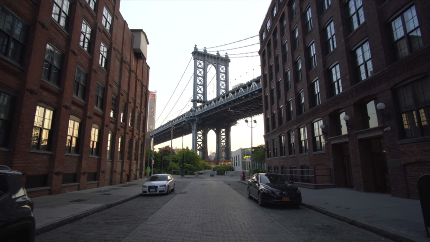 Brooklyn Bridge View from Dumbo Empty Neighborhood Street with Brick wall Apartment Buildings at Sunrise with no people Circa May 2018 Royalty-Free Stock Footage #1058741572
