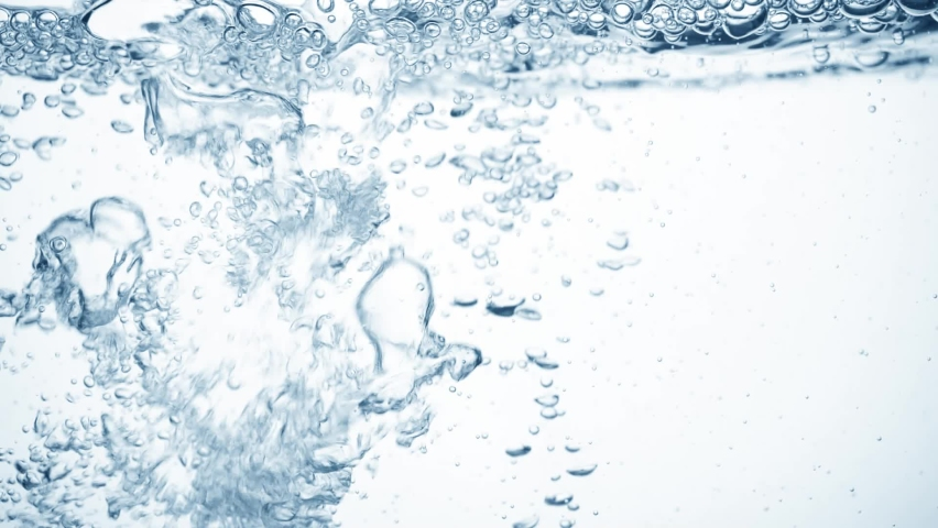 Large shiny drop of water in slow motion falls on smooth pure surface, creating air bubbles, splashes and ripples after falling into, side view. Freshness of clear blue liquid on white background | Shutterstock HD Video #1058748673