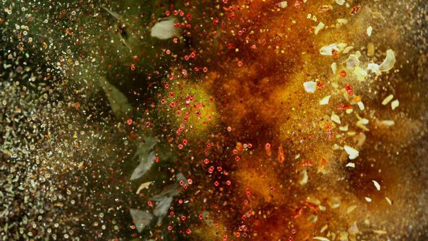 Super Slow Motion Shot of Colorful Seasoning Explosion on Black Background at 1000fps. Royalty-Free Stock Footage #1058754181