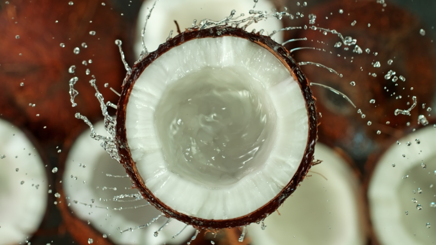 Super Slow Motion Shot of Splashing Water from Coconut at 1000fps.