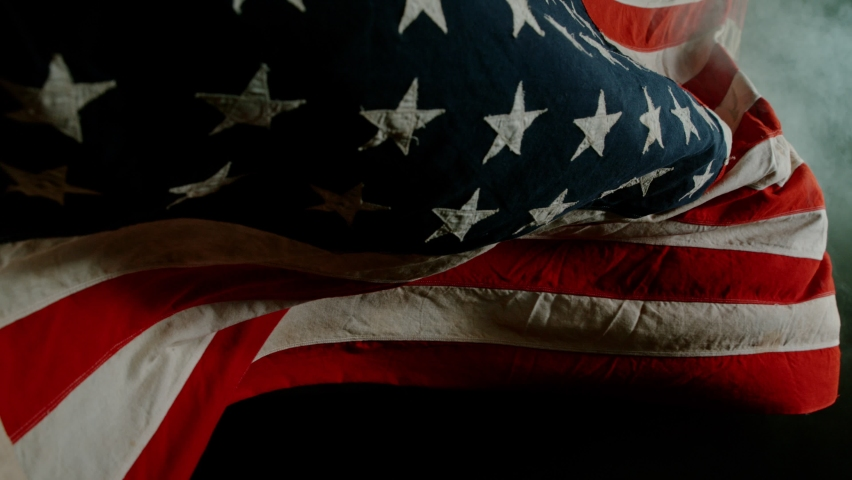 Close up of American Flag Waving. USA Banner Flaping in Wind. Concept of 4th of July, Independence Day, American Election and Other Feasts Royalty-Free Stock Footage #1058760232