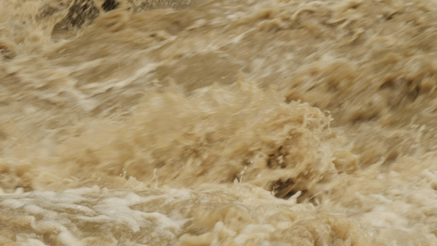 Disaster flood deluge and water flow after rainfall. Raging river with dirty water. Weather cataclysm. Natural disasters, extreme weather.