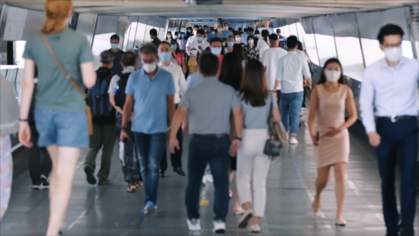 Slow motion of unrecognized people wearing medical face masks at metro in Hong Kong. Coronavirus concept | Shutterstock HD Video #1058766679