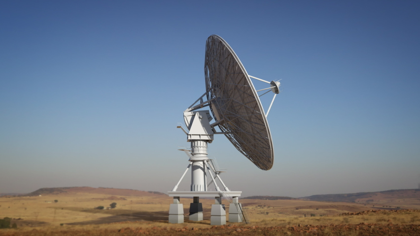Large ground satellite isolated on desert environment, big satellite dish rotating in loop searching the sky during day.   Shutterstock HD Video #1058779006