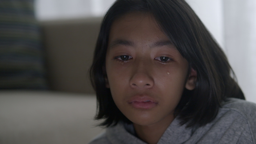 Close up of Asian little girl crying and tears. Asia girl have sad emotion and facial expressions   Shutterstock HD Video #1058804227