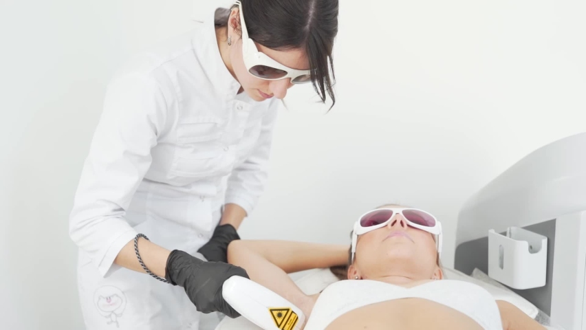 Young Female Doctor Performs Armpit Hair Ral Procedure | Shutterstock HD Video #1058805775