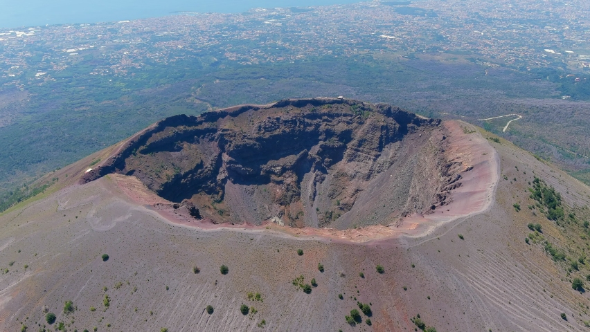 Aerial view of volcano Mount Vesuvius, rough volcanic terrain inside crater on top of mountain - landscape panorama of Naples from above, Italy, Europe Royalty-Free Stock Footage #1058816869