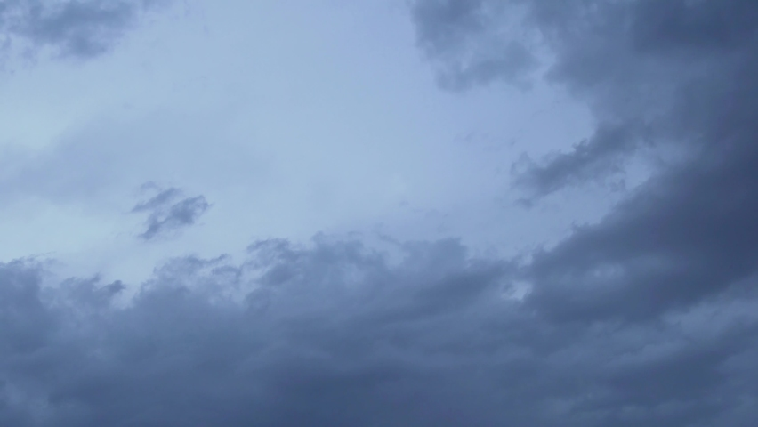 Dramatic Gray Black Dramatic Gray Clouds with an Impending Storm. Background of Rain Clouds and Stormy Sky. Time Lapse of Storm Clouds in a Dark Gray Sky. | Shutterstock HD Video #1058818138