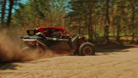 SLOW MOTION. Buggy car driving fast in cross country road. Fast rally auto is going with big clouds of dust. Speed riding of a racing off-road car in the forest road. Cinematic sport clip.