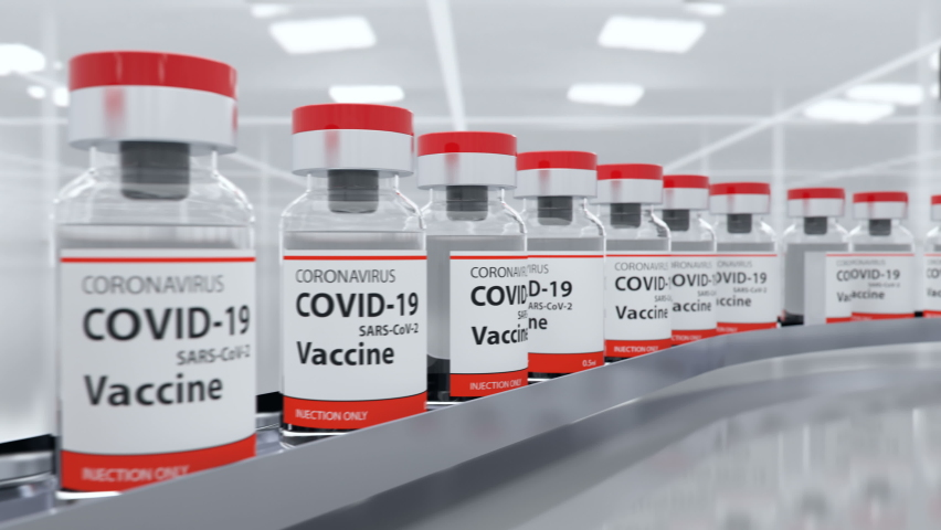 COVID-19 vaccine has been developed and ampoules with coronavirus vaccine moves to the packing on the pharmaceutical production line. It's for injecting medical professionals and people at risk, loop | Shutterstock HD Video #1058867644