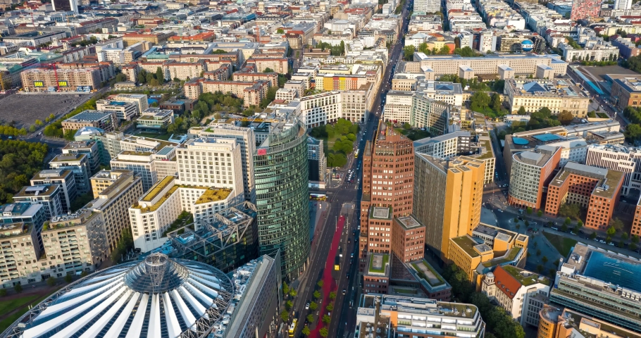 BERLIN, GERMANY - September 11, 2020: Aerial view of the Bahntower and Sony Center at Potsdamer Platz. The iconic skyscrapers of Potsdamer Platz have become a major tourist attraction. Time lapse 4K.
