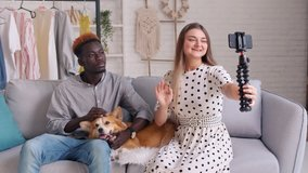 A Bloggers Creating a New Content for Video Blog. Cute Lady and Young Man Shares the News With Her Followers during Vlogging. Black Beauty Influencers