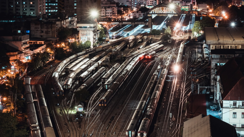 Time-lapse of old trains parking in rail yard at Hua Lamphong train station in Bangkok city, Thailand. Railway transportation concept. High angle view, tilt up then still Royalty-Free Stock Footage #1058880883