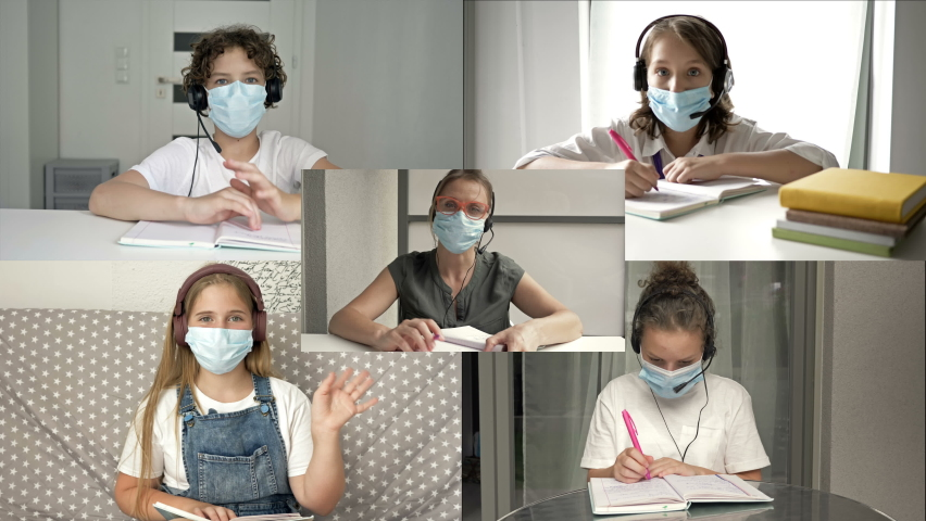Distance learning. On the monitor screen, teacher and students in protective masks. Prevention of coronavirus infection. Back to school. | Shutterstock HD Video #1058906576
