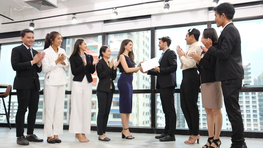 Group of multiracial business corporation celebrating together in the meeting room with CEO given certificate to the branch manager while the rest of employees are cheerfully applauding  Royalty-Free Stock Footage #1058917991