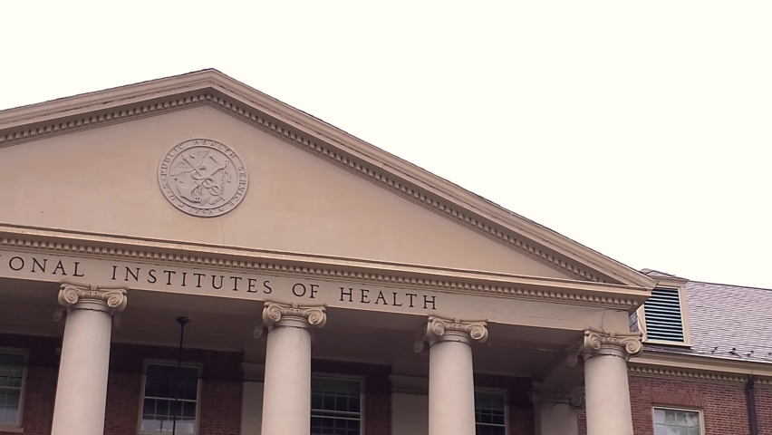 Bethesda, MD, USA: 09/12/2020: View of the main historical building (Building 1) of the National Institutes of Health (NIH) inside Bethesda campus. U.S. Public Health Service seal is seen on top of it