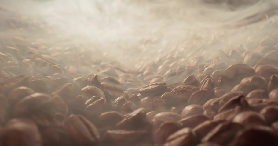 Close up of seeds of coffee. Fragrant coffee beans are roasted smoke comes from coffee beans. | Shutterstock HD Video #1058926337