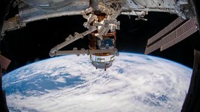 4K time lapse of Earth from Space featuring the Canada Arm module of the International Space Station. Image courtesy of NASA.