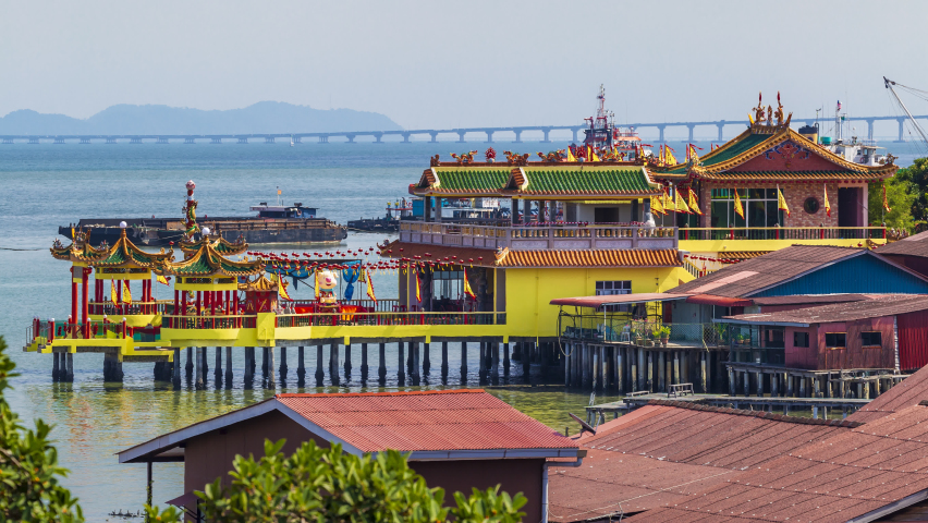 Aerial view cityscape and boats traffic in harbor Near Hean Boo Thean Kuan Yin Temple, Traditional Chinese place of worship over the water in Clan jetties Georgetown, Capital of Pulau Penang, Malaysia