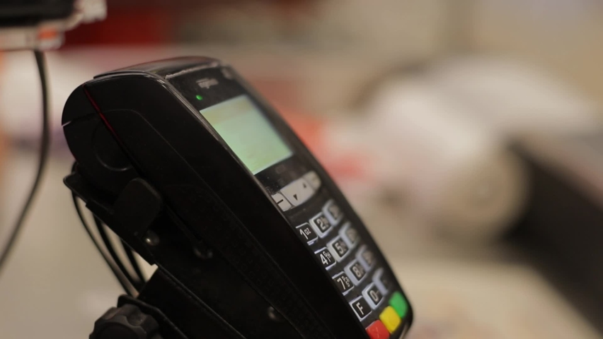Payment for goods at the checkout using a smartphone. Contactless payment in the store terminal Royalty-Free Stock Footage #1058955605